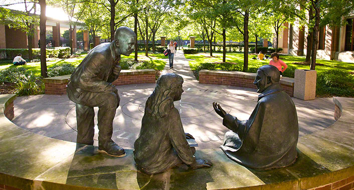 On-campus statues conversing