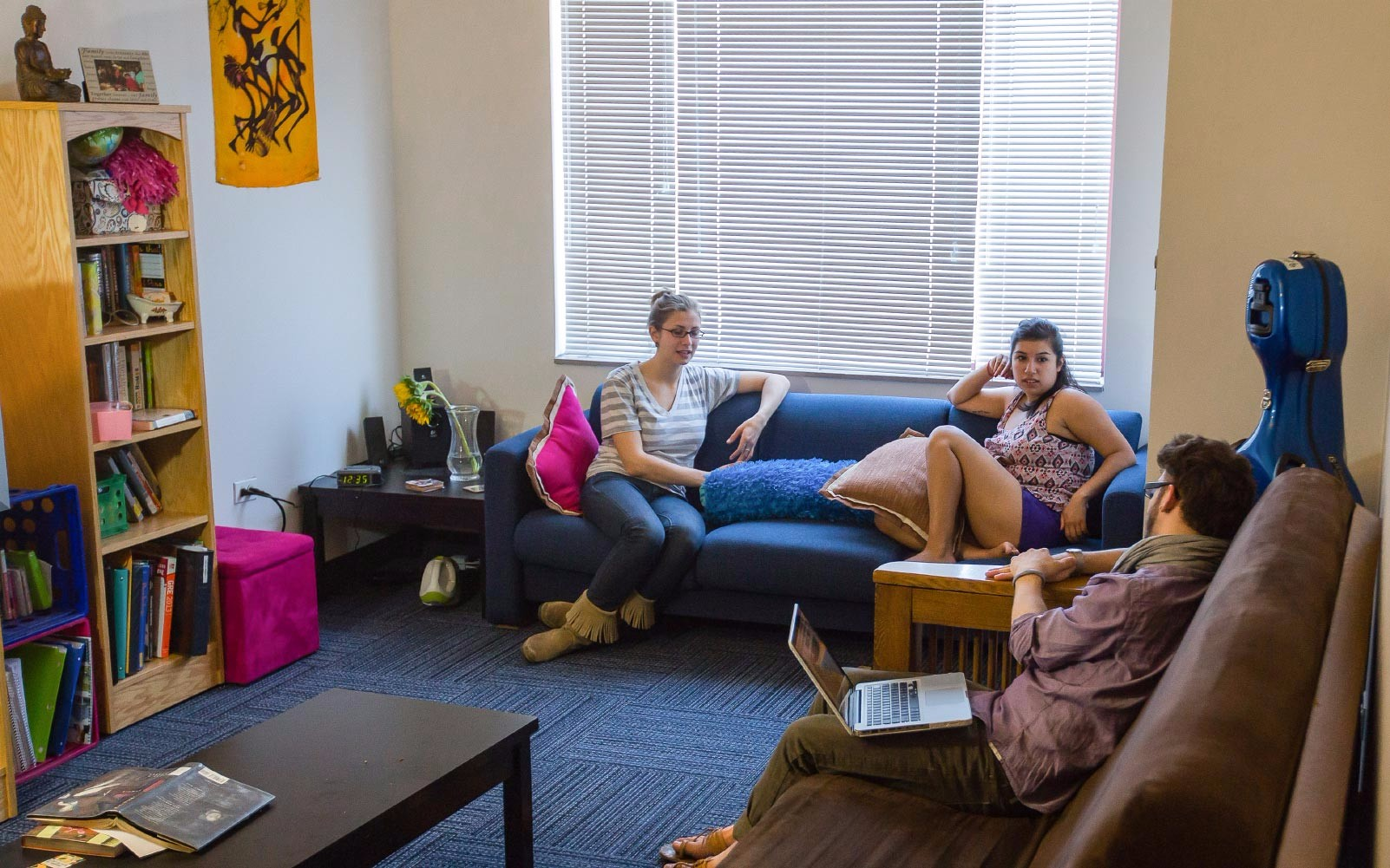 Students lounging in a dorm room.