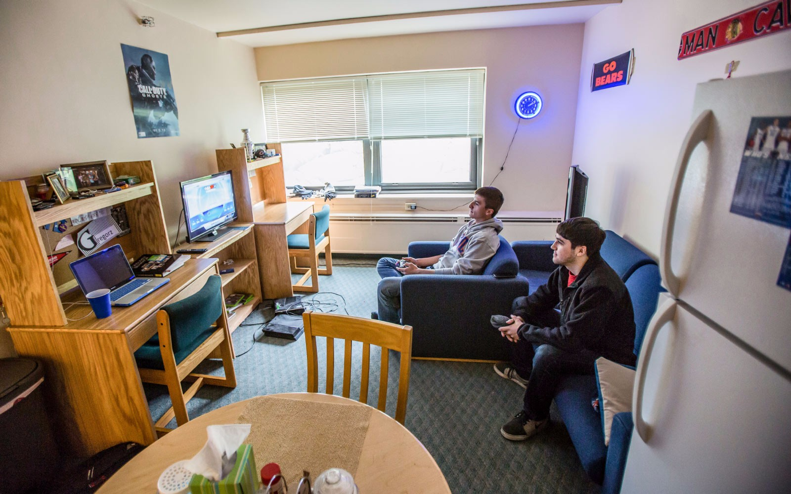 Students talking in a dorm room.