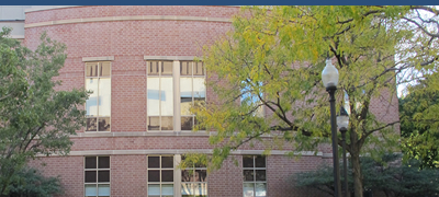 DePaul Lincoln Park Campus building with trees that have changing leaves in front