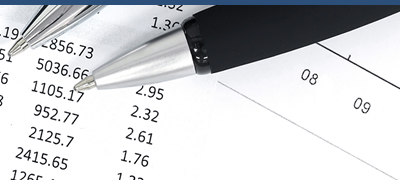 Pens and documents with numbers on a desktop