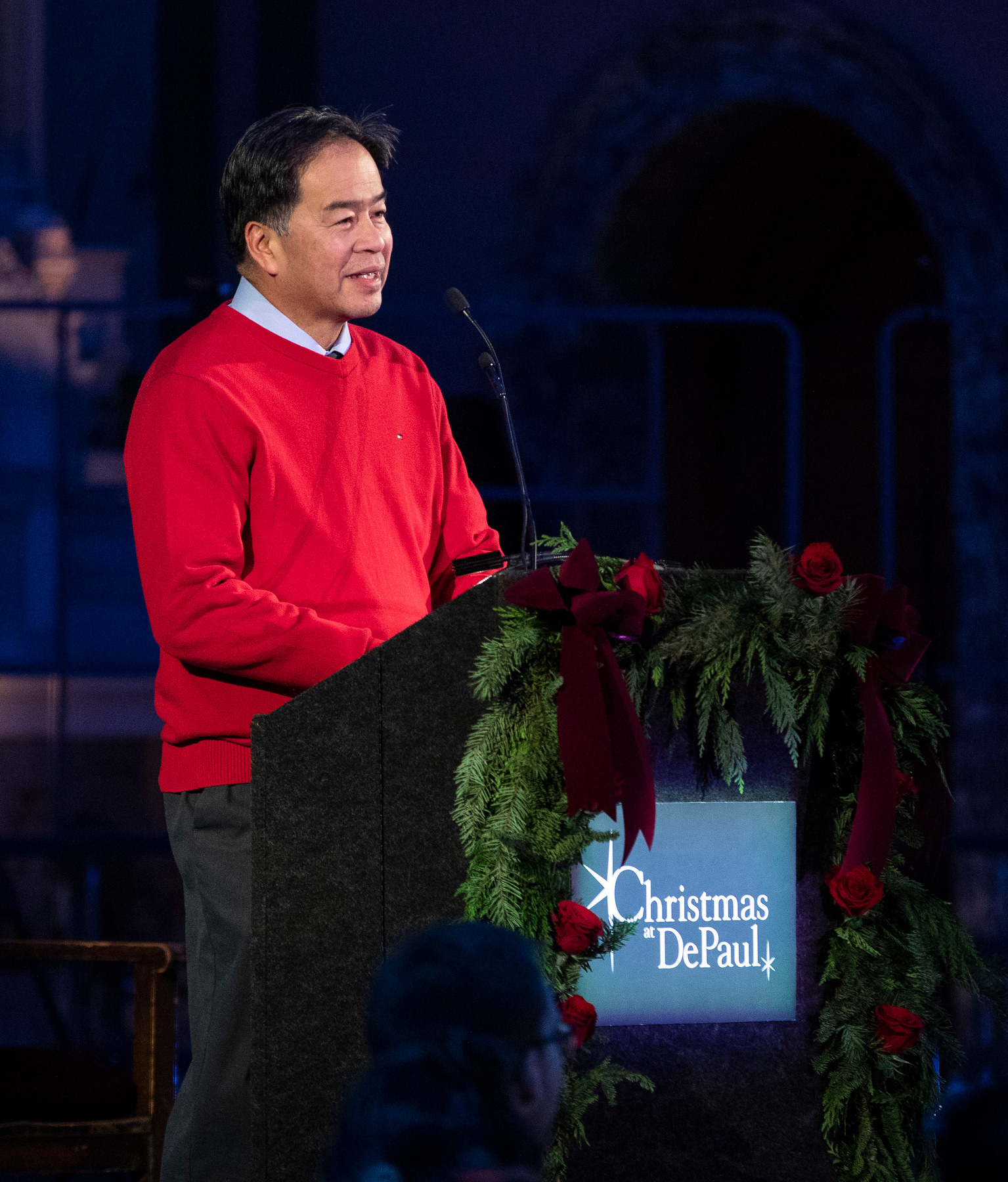 A. Gabriel Esteban, Ph.D., president of DePaul, greets the audeince inside St. Vincent de Paul parish Church for the seaon's first peformance of Christmas at DePaul. (DePaul University/Jamie Moncrief)