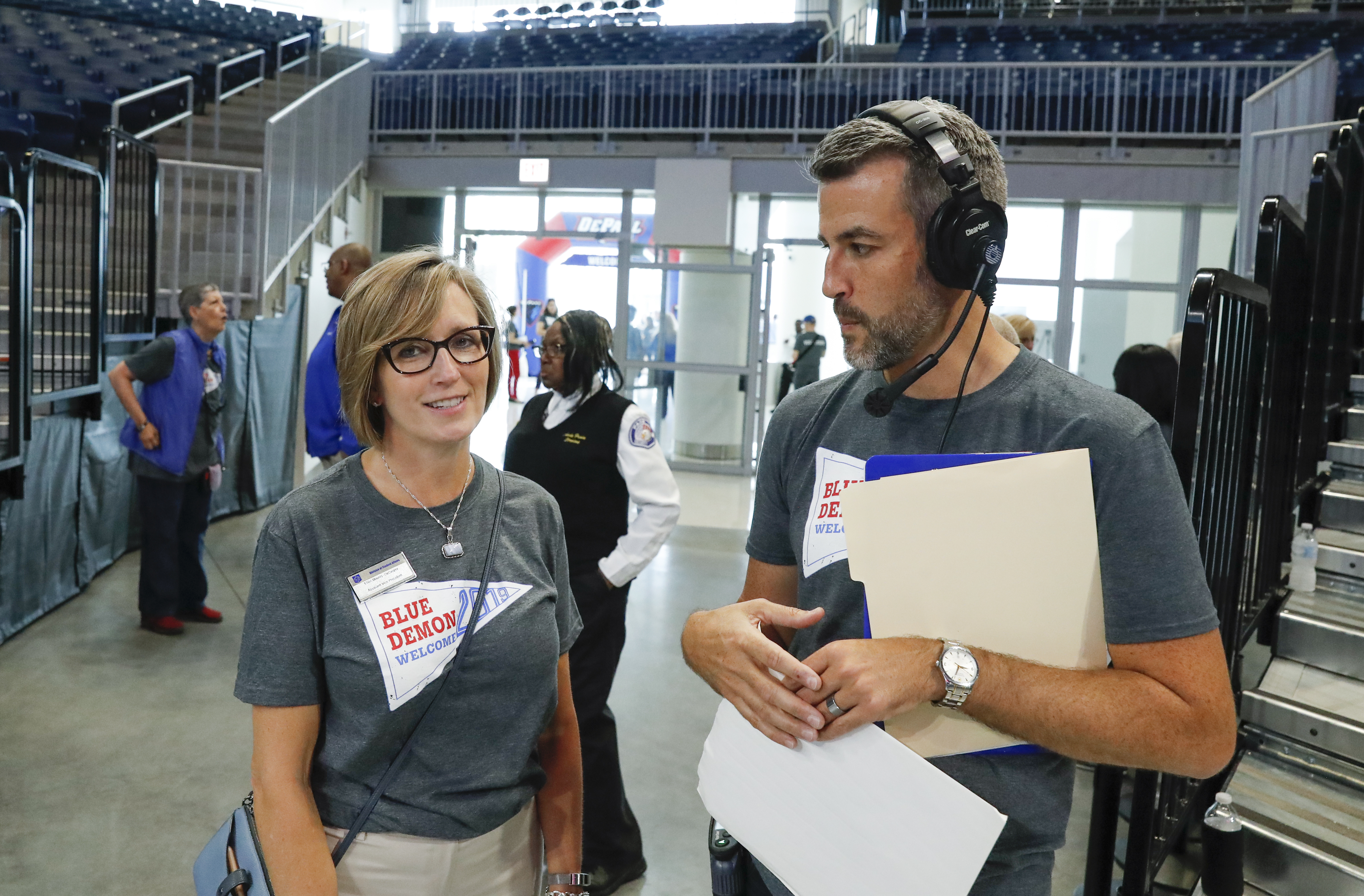 Director of New Student and Family Engagement and event organizer Tom Menchhofer (right) and Ellen Meents-DeCaigny of Student Affairs (left)