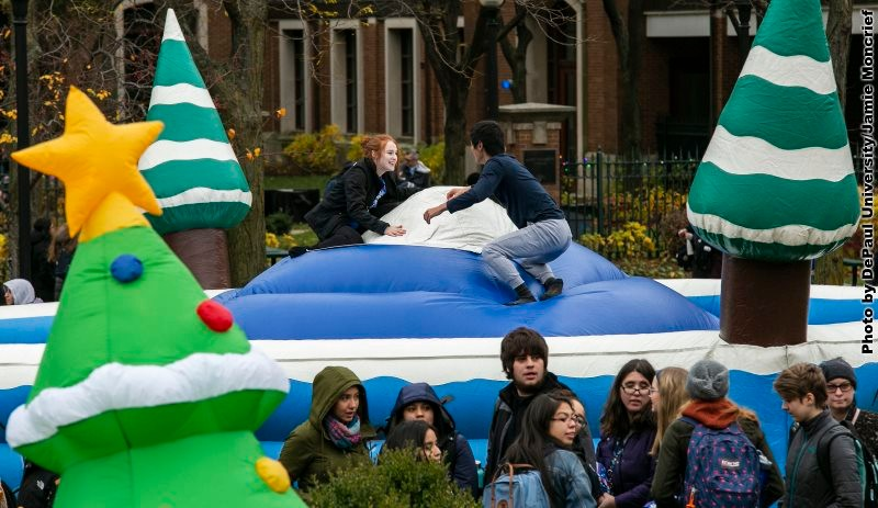 Two students on large bounce object