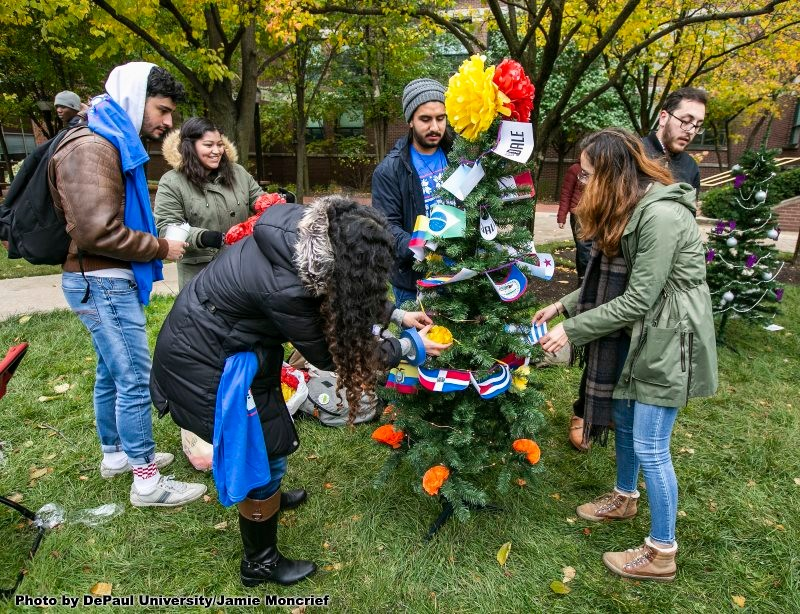 Students decorate Christmas tree