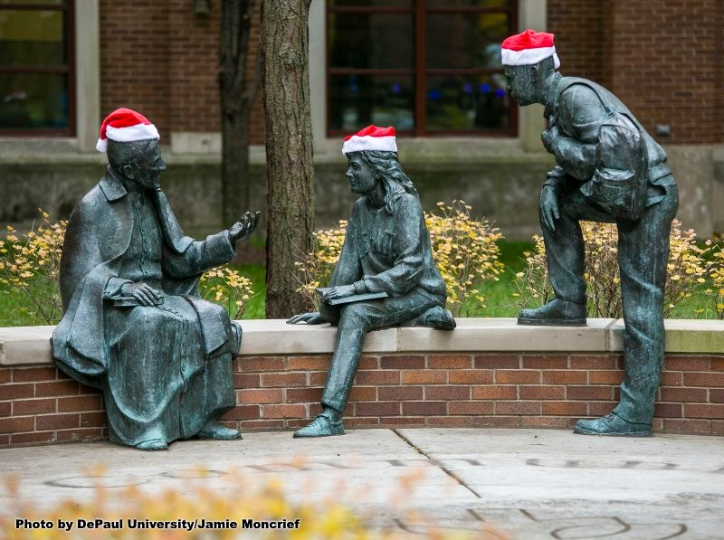 St. Vincent's Circle statues with holiday hats on