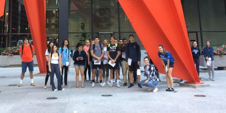 Student group in front of Flamingo sculpture